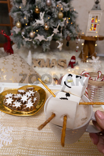 Marshmallow snowman float in hot chocolate at Christmas