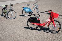 Bicycle sharing bikes for rent from DEEZER, LIDL and JUMP by UBER on street in Berlin