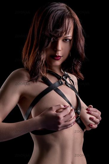 Woman dressed in sword belt, panties and stockings