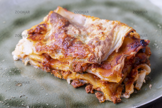boiled lasagne on a green plate