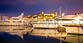 Cannes. Old town of Cannes on French riviera yachting harbor evening view