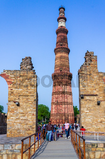 Qutb Minar with antic ruins of the surrounded complex. UNESCO World Heritage in Mehrauli, Delhi, India, Asia.