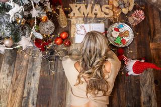 Female writes a Christmas shopping list