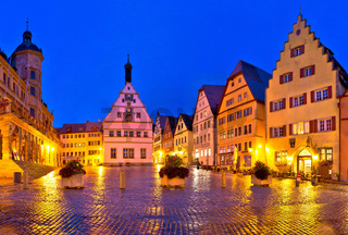 Main square (Marktplatz or Market square) of medieval German town of Rothenburg ob der Tauber evening panoramic view.