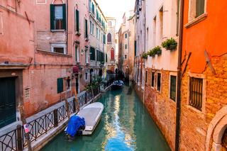 Venice cityscape, narrow water canal