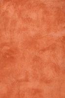 Grunge orange painted plaster wall background