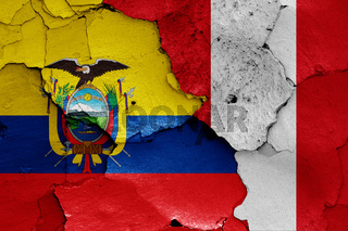 flags of Ecuador and Peru painted on cracked wall