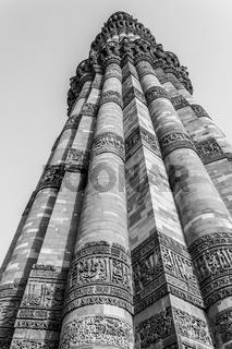 Close-up of Qutb Minar with motifs on upper levels. UNESCO World Heritage in Mehrauli, Delhi, India, Asia.