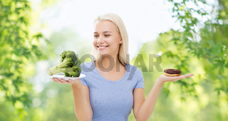 smiling woman with broccoli and donut