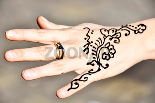 tatoo henna and hand with ring, photo as background