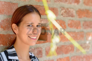 Smiling relaxed young woman glancing sideways