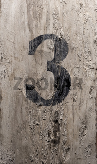 The number three painted on old timber post