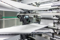 Folding Machines in Printing Production Factory Industrial Equipment Detail Closeup