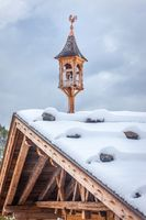 Snowy belfry on a hut