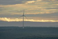 Wind turbine for power generation with clouds, Fraenkische Alb, Bavaria