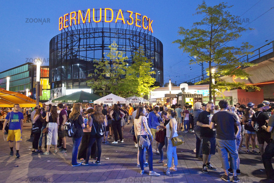 Many people at dusk in the entertainment district of Bemudadreieck, Bochum, Germany, Europe