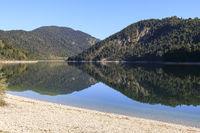 Sylvenstein reservoir with reflection, Bavaria, Germany