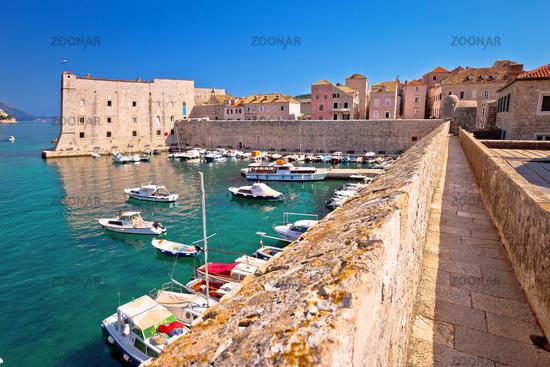 Dubrovnik. Historic city walls walk and Saint Ivan fortress in Dubrovnik harbor view