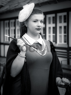 Attractive woman in vintage style clothes