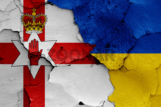 flags of Northern Ireland and Ukraine painted on cracked wall