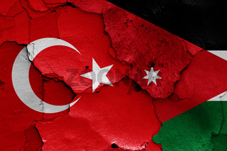 flags of Turkey and Jordan painted on cracked wall