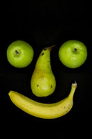 Smiling fruit face with apple eyes
