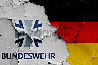 flags of Bundeswehr and Germany painted on cracked wall
