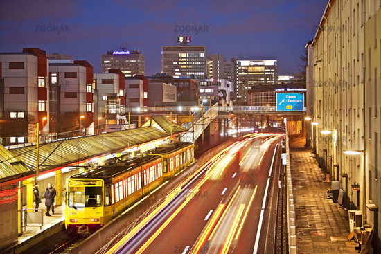 motorway A40 with tram downtown in the evening, Essen, Ruhr Area, Germany, Europe