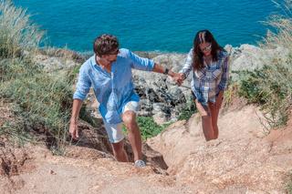 Couple on vacation explore coastline