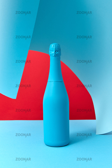 Holiday wine mock-up bottle painted blue with soft shadows.