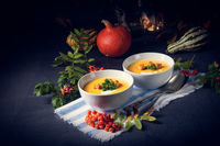 Delicious pumpkin soup with croutons and coconut milk