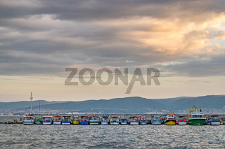 Fishing Boats docked at a harbor port at sunrise in Nessebar ancient city on the Bulgarian Black Sea Coast. Nesebar or Nesebr is a UNESCO World Heritage Site. Boats at sunrise in Nessebar