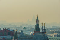 Moscow Kremlin tower, city roofs, silhouette of the Moscow State University