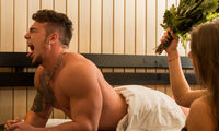 Young sexy couple taking a steam bath with broom