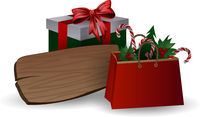 Festive composition with Christmas tree branches in a gift bag and boxes with bows on a white background.