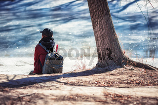 Girl Sitting on River Bank Tree Backpack Cool Fashion Asian Clothes from Behind, Quiet Scene