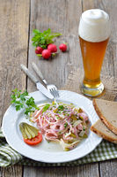 Sausage salad with a cool wheat beer