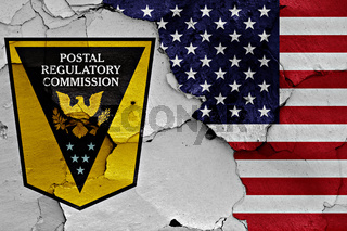 flags of Postal Regulatory Commission and USA painted on cracked wall