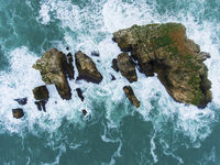 Islands in Costa Quebrada, Liencres, Cantabria, Spain