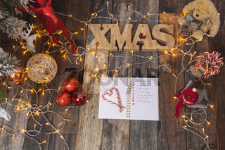 Christmas List on rustic wood with Christmas decorations