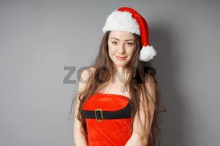 smiling miss santa wearing christmas costume