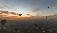 Aerial view of Cappadocia at sunrise with hot air balloons