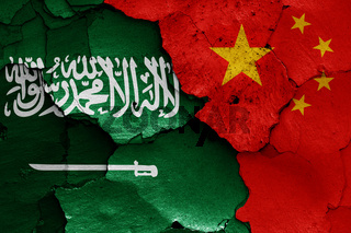 flags of Saudi Arabia and China painted on cracked wall