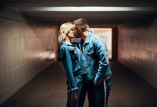 Sensual couple kissing in underground crossing