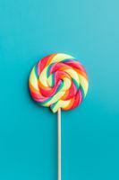 Colorful rainbow swirl lollipop.
