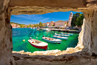 Turquoise waterfront of Cavtat view through stone window