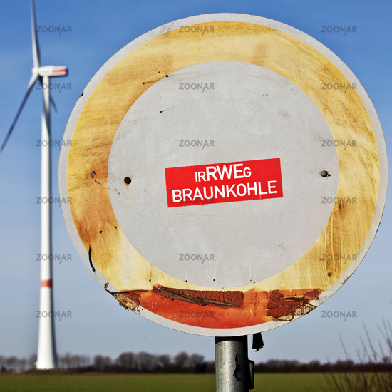 Ban road sign with sticker IrRWEg lignite and wind turbines, Grevenbroich, Germany, Europe