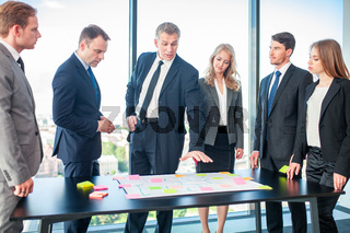 Business team with colour notes