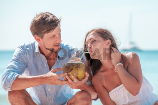 Couple drinking coconut cocktail
