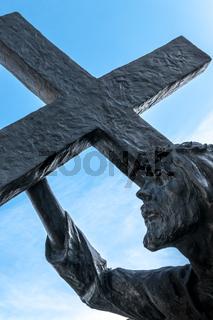 Bronze statue of Jesus carrying his cross
